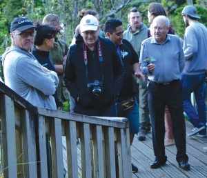 Visitors experience the Maori culture at Bridal Veil Falls, Raglan
