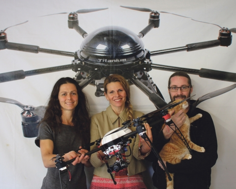 Left: Sarah, Linda and Hadley with the Aeronavics drone. Right: Aeronavics drone footage shows rhinos filmed using thermal imaging.