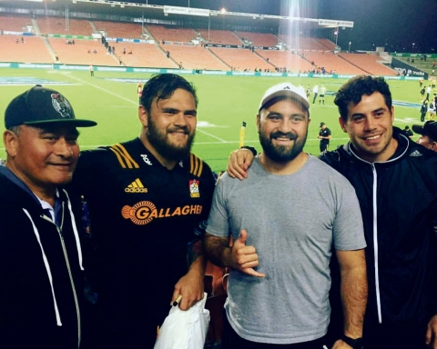 Angus in his Chiefs jersey, flanked by members of his family, from left, Fua, Angus, Stuart and Rupert Taavao.