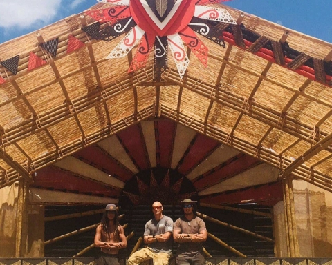 From left, Te Ata, Gerard and Herewini  in front of some of the bamboo structures they learned to build.