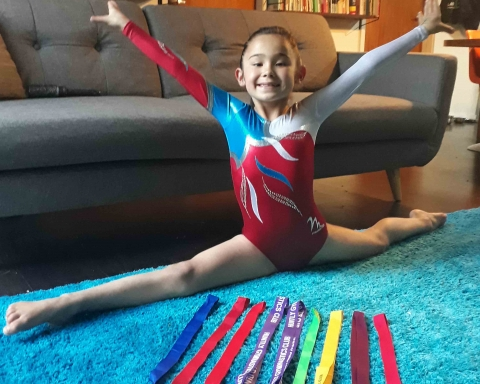 Young gymnast, Miko Hutt, pictured with medals from recent competitions.