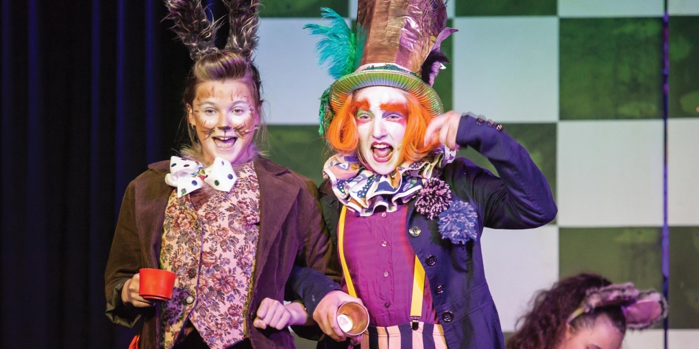 From left, Coco Smith as the March Hare and Zoe Oliver as the Mad Hatter in Alice.                                                       Image Credit // Leanne Roughton