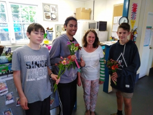 Connor Marquand, Emanual Ringia and Boston Abraham spread kindness with flowers.